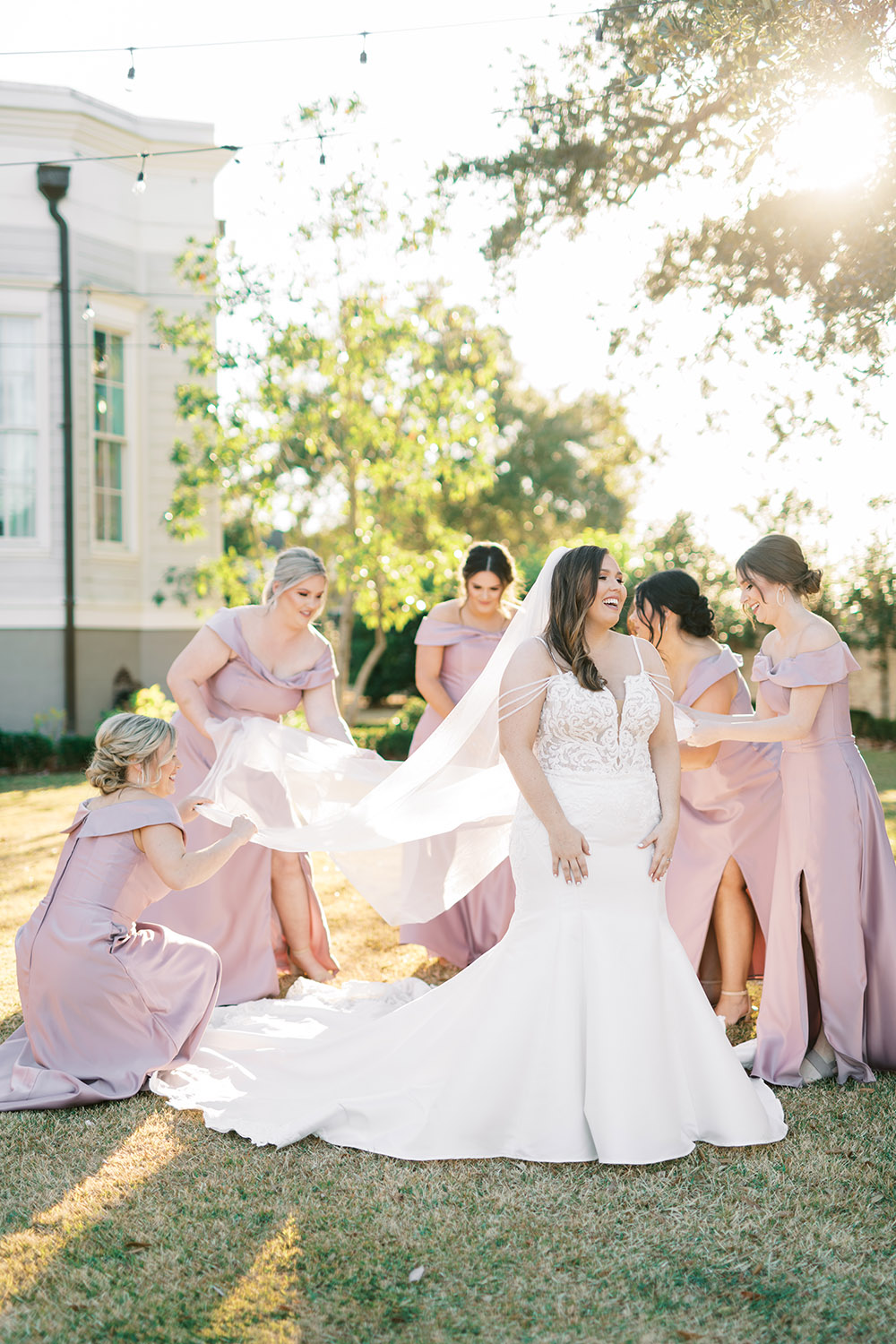 Bridesmaids fix the bride's veil by Peony Photography