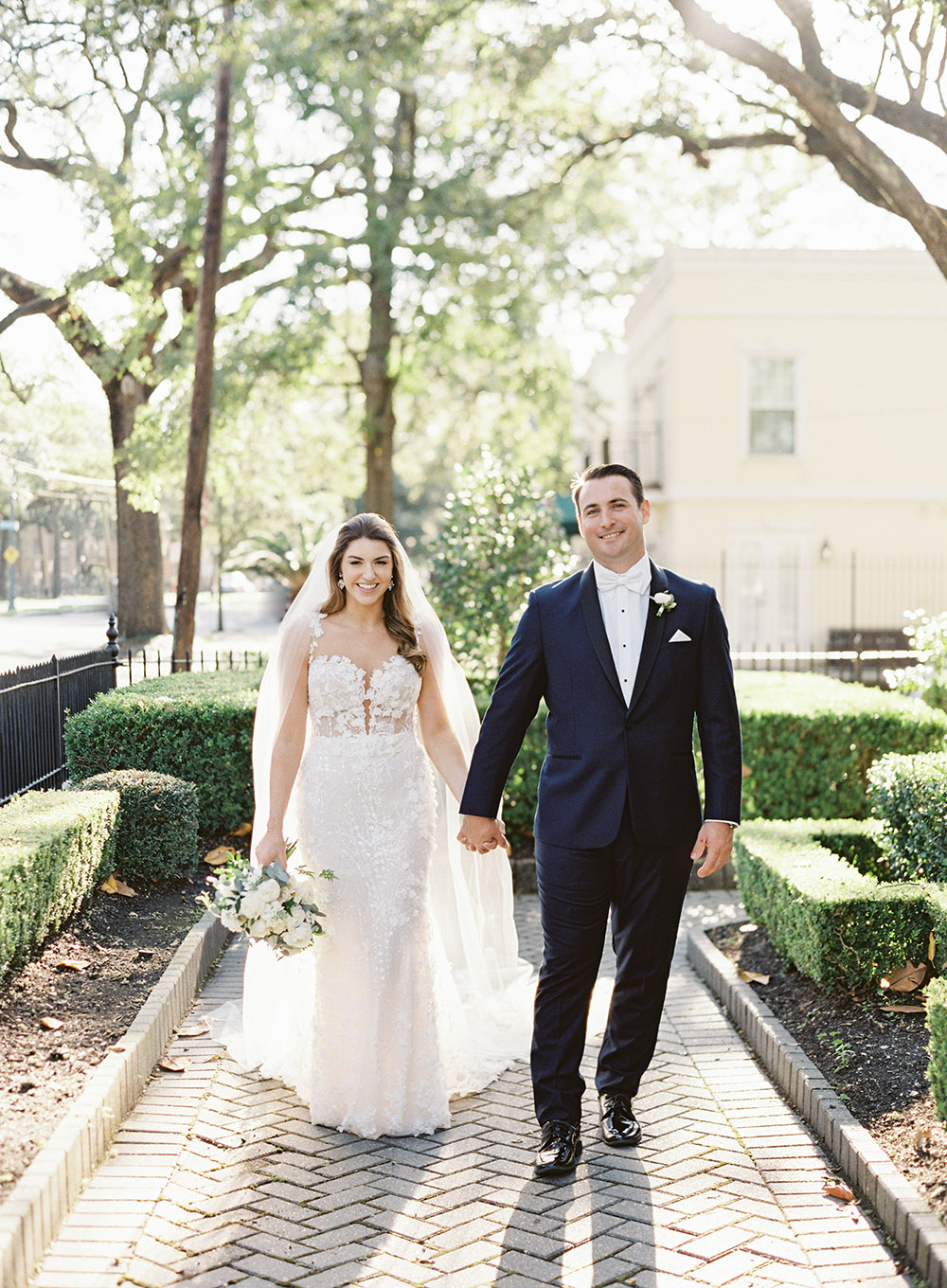 Bride and Groom hold hands by Peony Photography