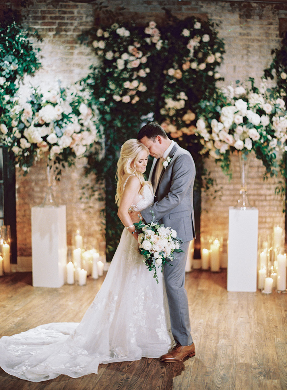 Bride and groom kiss at The Chicory in New Orleans by Peony Photography