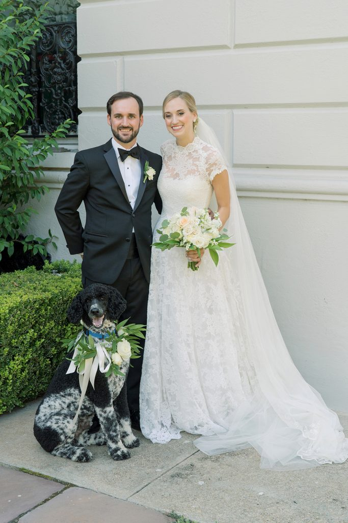 Bride and groom with their dog by Eau Claire Photographics