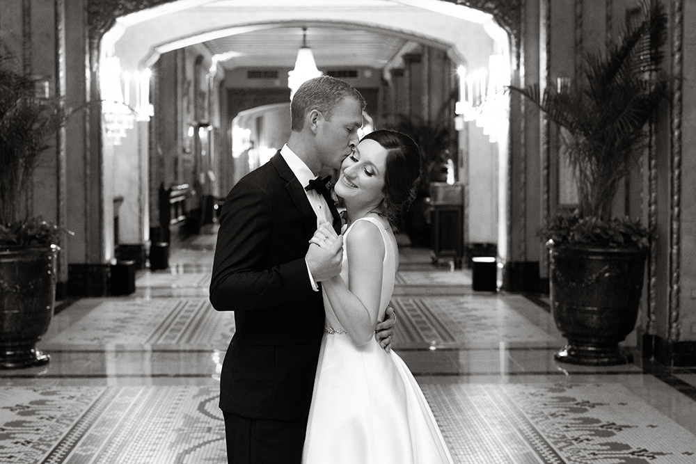 Bride and groom in the Roosevelt New Orleans lobby by Eau Claire Photographics