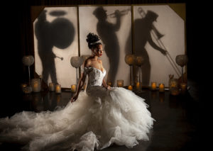 A bride with Jazz musicians behind a screen. Photo by Jessica Burke