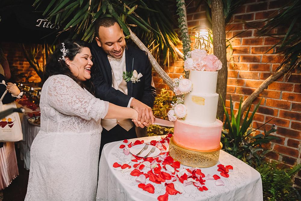 Mari and Ian cut the wedding cake. Photo: Rare Sighting Photography