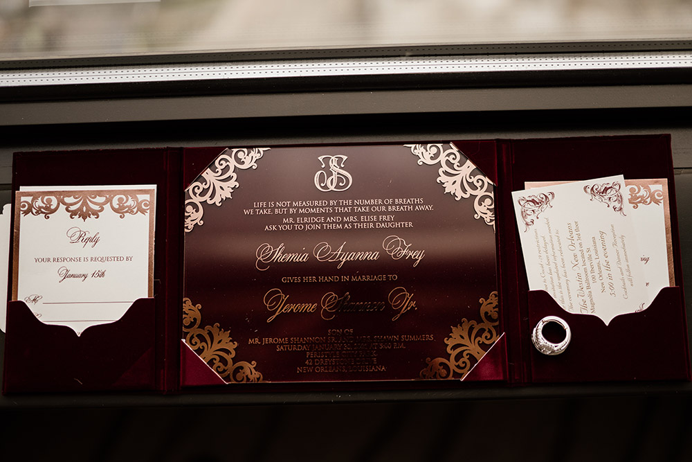 Burgundy and gold wedding invitation | photo by Audie Jackson