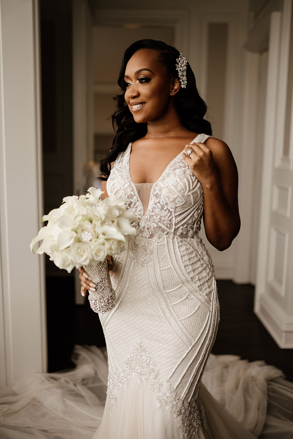 Shemia wore a beautiful Badgley Mischka gown and carried a bouquet of white roses and lilies. | Photo by Audie Jackson