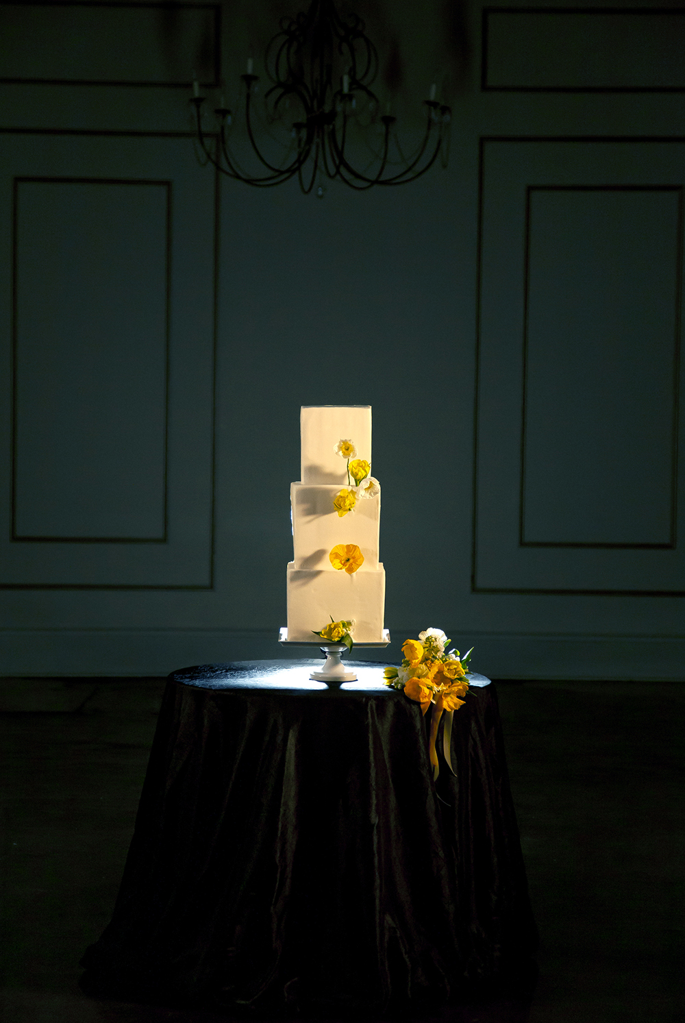 Wedding Cake by Gambino's Bakery with yellow poppies by Fat Cat Flowers.