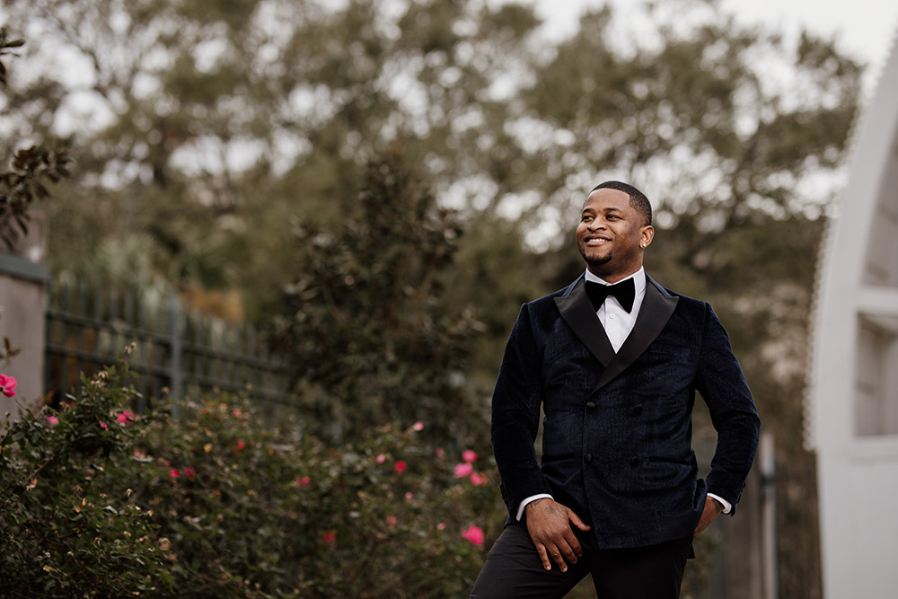 Jerome wore a custom tailored tuxedo by Luca Falcone. Photo by Audie Jackson