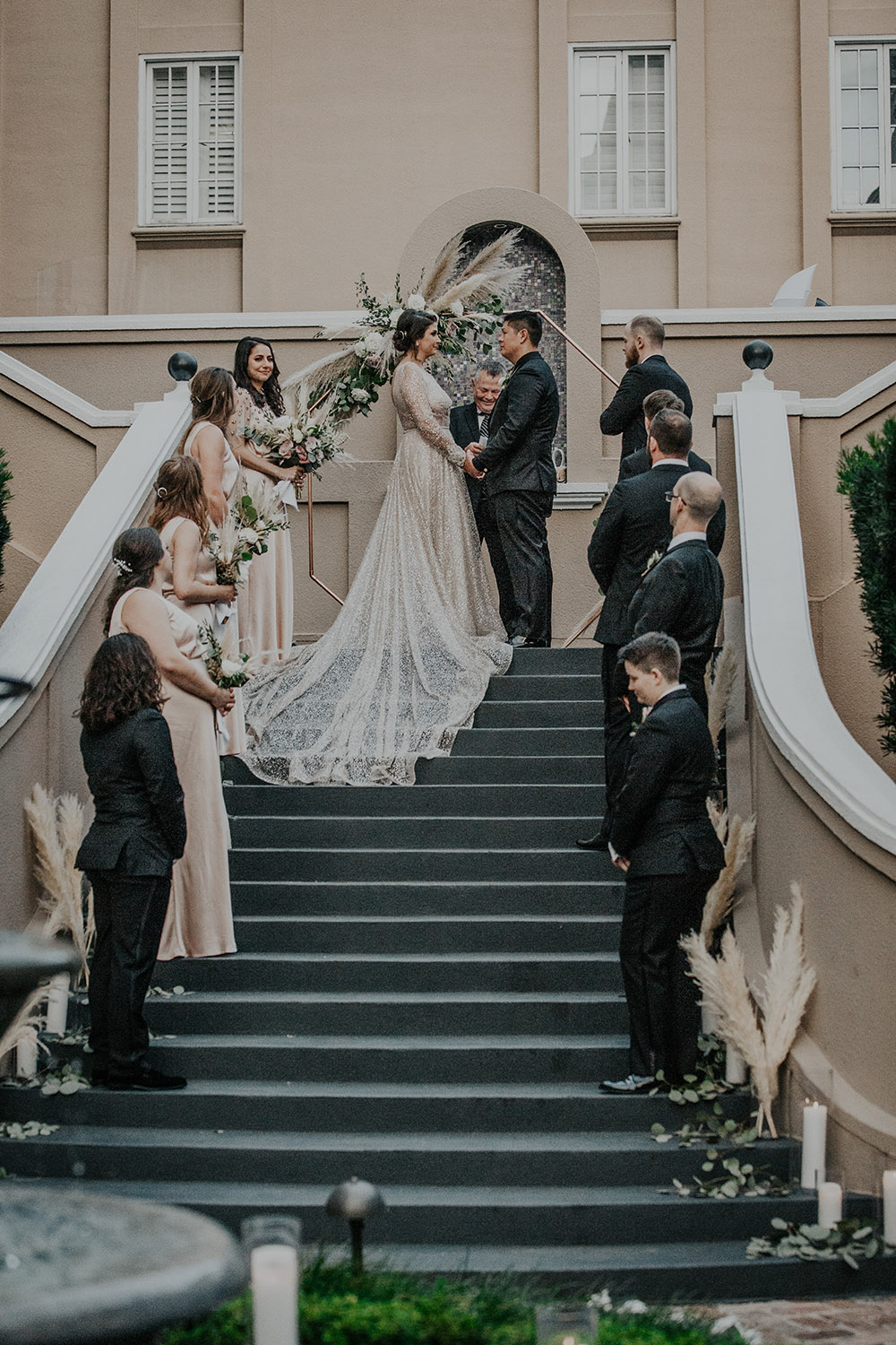 The wedding ceremony on the steps of the W French Quarter courtyard. Photo: Sara Ann Green Photography