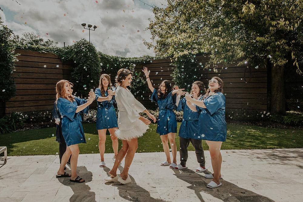 Bridesmaid's pop confetti. Photo: Sara Ann Green Photography