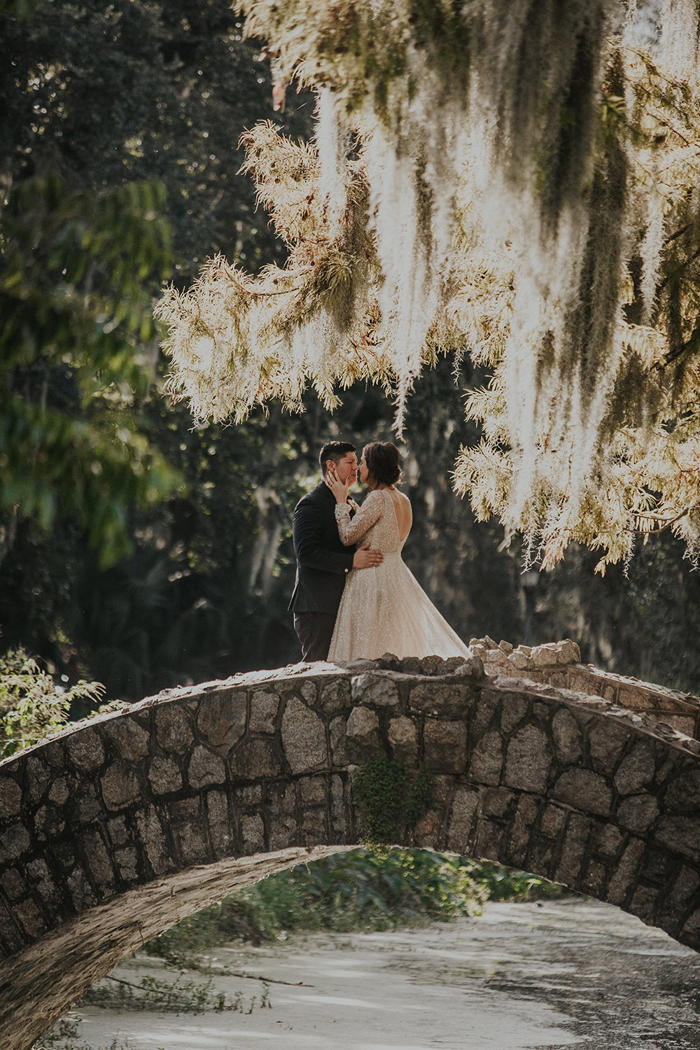 The couple kiss on a bride in New Orleans City Park. Photo: Sara Ann Green Photography