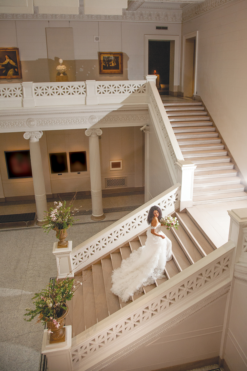 Lyn ascends the grand staircase in the New Orleans Museum of Art Freeport-McMoran Great Hall.