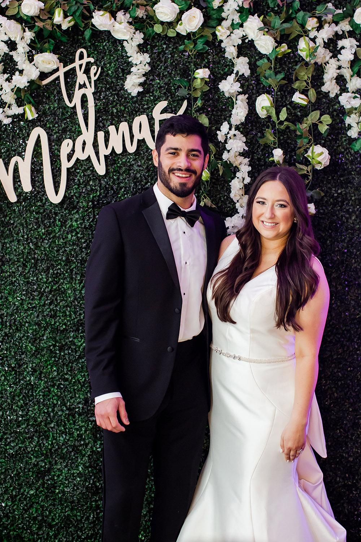 Greenery Wall photo backdrop at the reception.