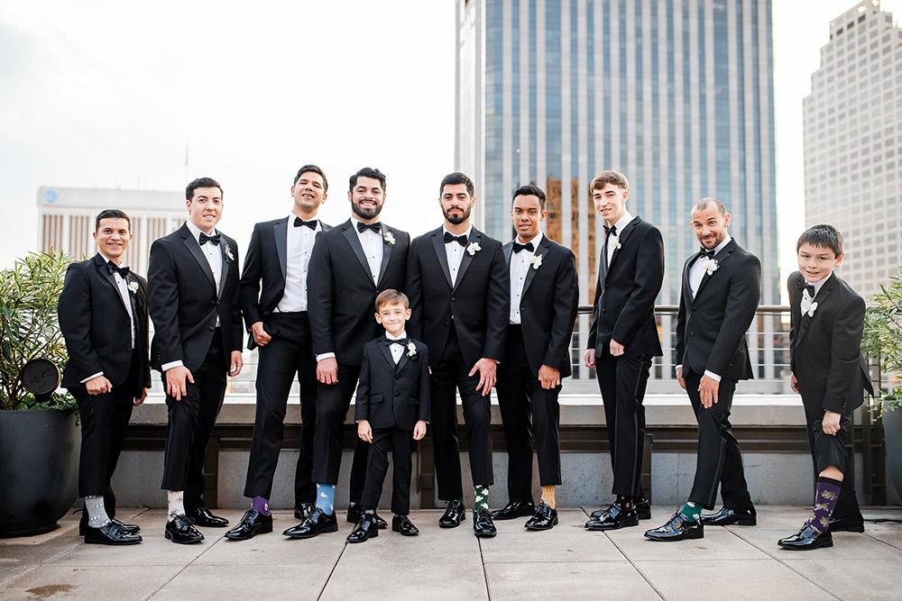 Julius and his groomsmen show off their Bonfolk socks.