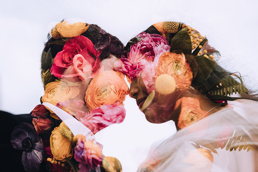 Double exposure of Erik and Isabella's profiles with the wedding bouquet.