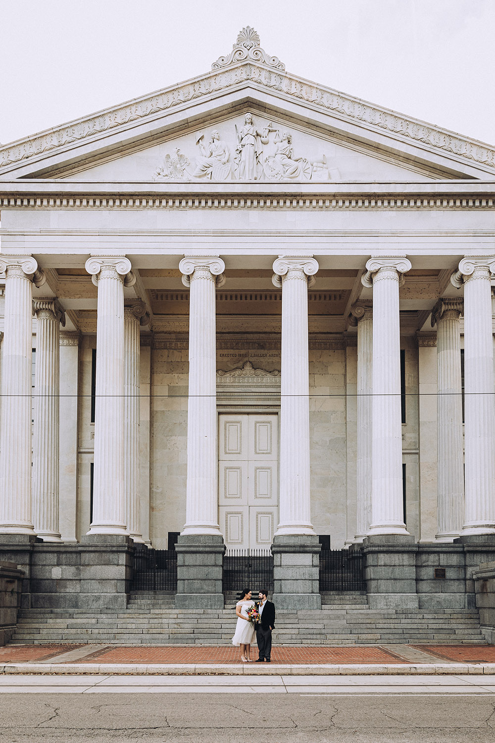 Isabella and Erik pose in front of Gallier Hall.