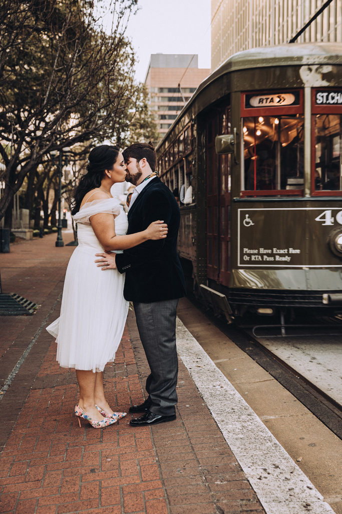 Isabella and Erik kiss as the St. Charles Streetcar passes.