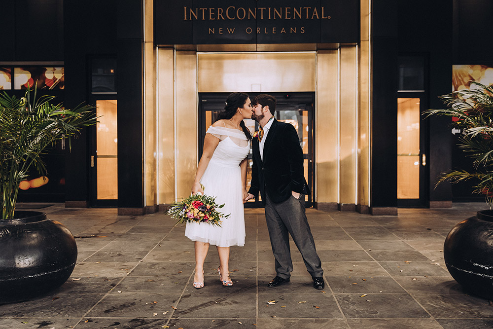 The Bride And Groom Kiss Outside The InterContinental New Orleans Hotel Entrance.
