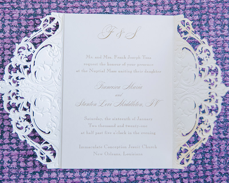 The lace, laser cut invitations by Rudman's Gifts.