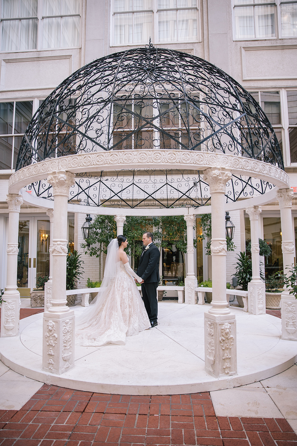 Francesca and Stanton's first look in the Ritz Carlton's courtyard.