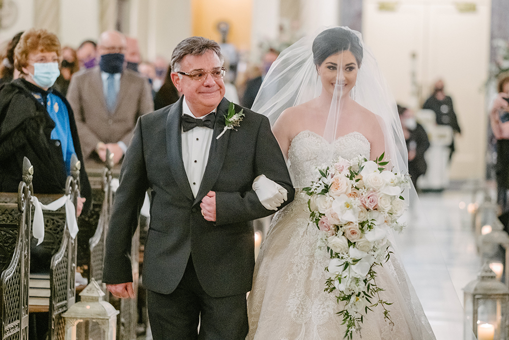 Francesca's father walks her down the aisle.