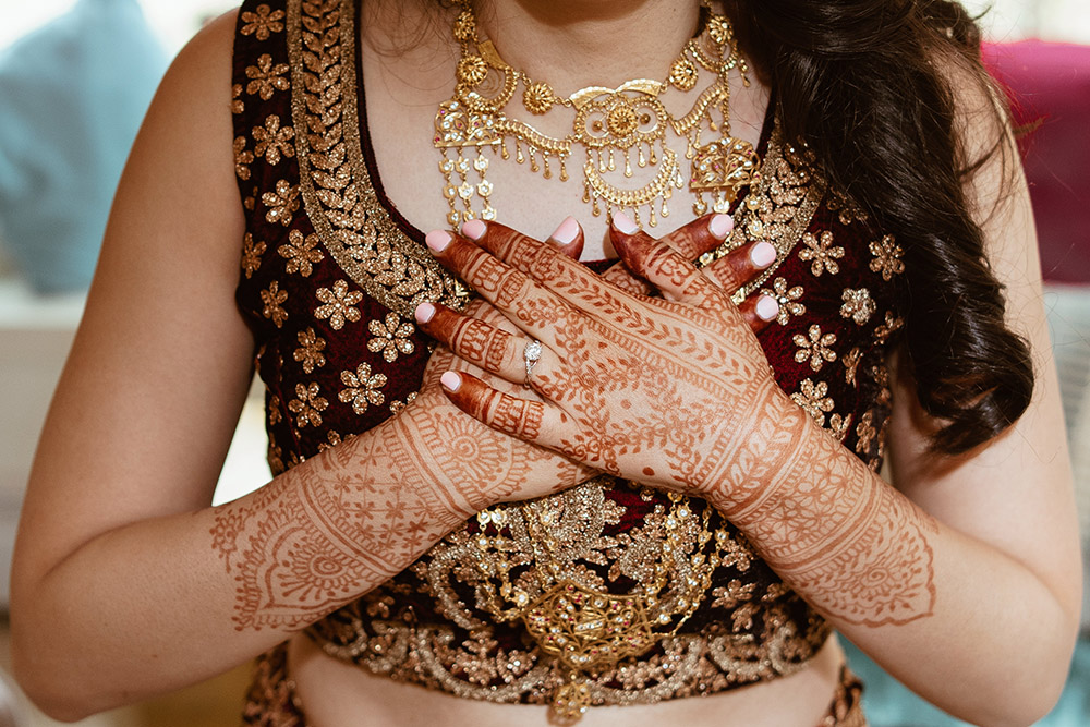 A bride wears a lab-created diamond engagement ring from Brilliant Earth. Photo: Dgass Photography