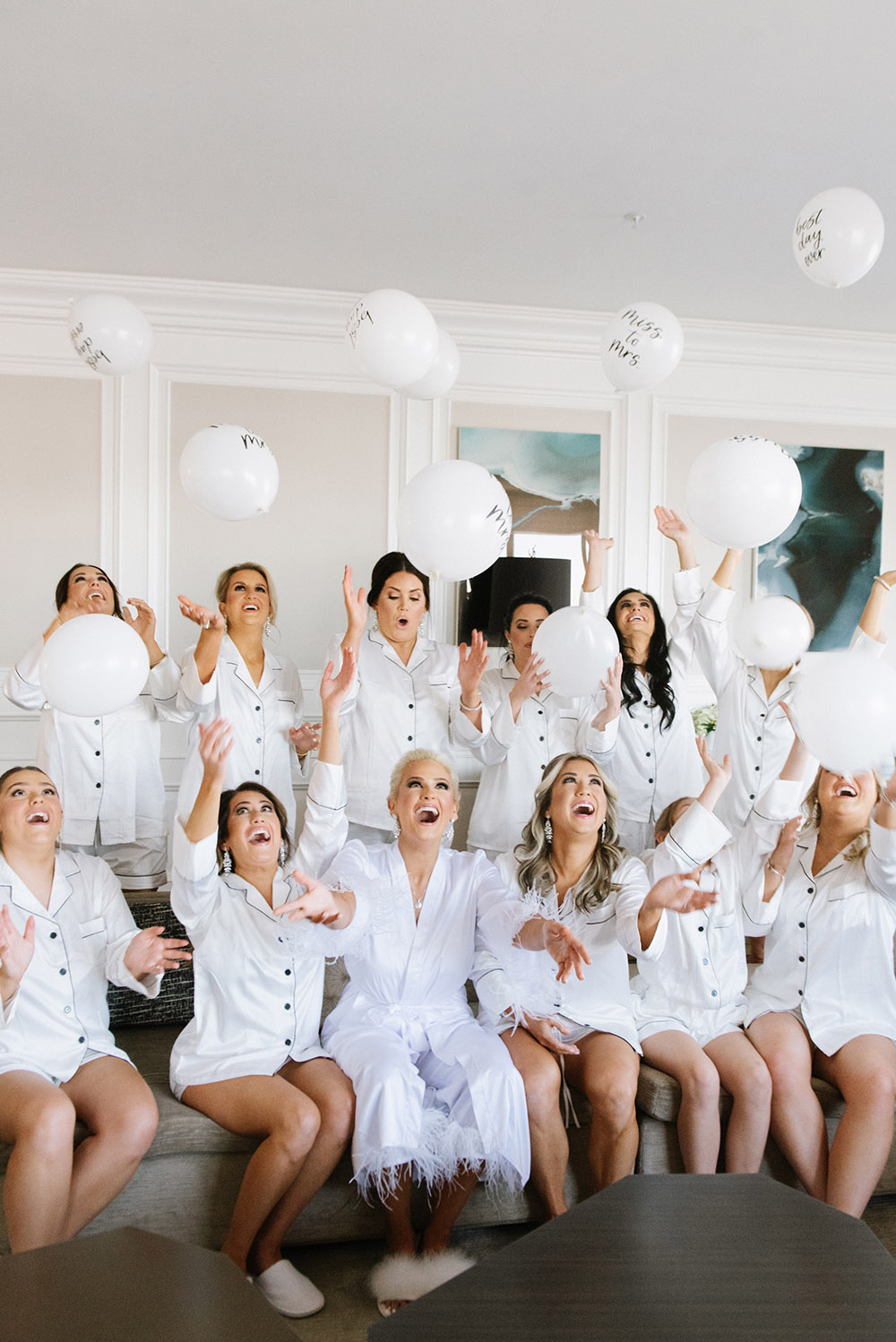 The bride and bridesmaids celebrate before the wedding