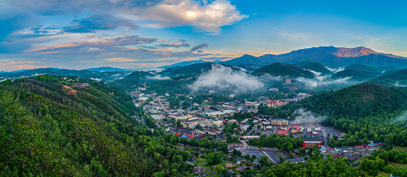 Gatlinburg, Tennessee, USA Downtown Skyline Aerial Panorama. Photo: Kevin Ruck