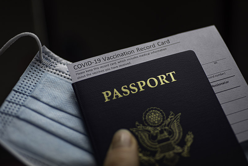 COVID-19 Vaccination Record card, Passport of USA and Medical Mask.