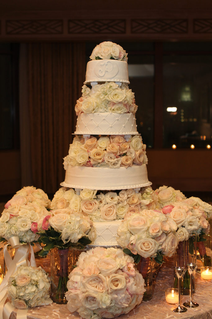 Four tier wedding cake with fresh flowers between tiers by Haydel's Bakery | Photo by Jessica The Photographer