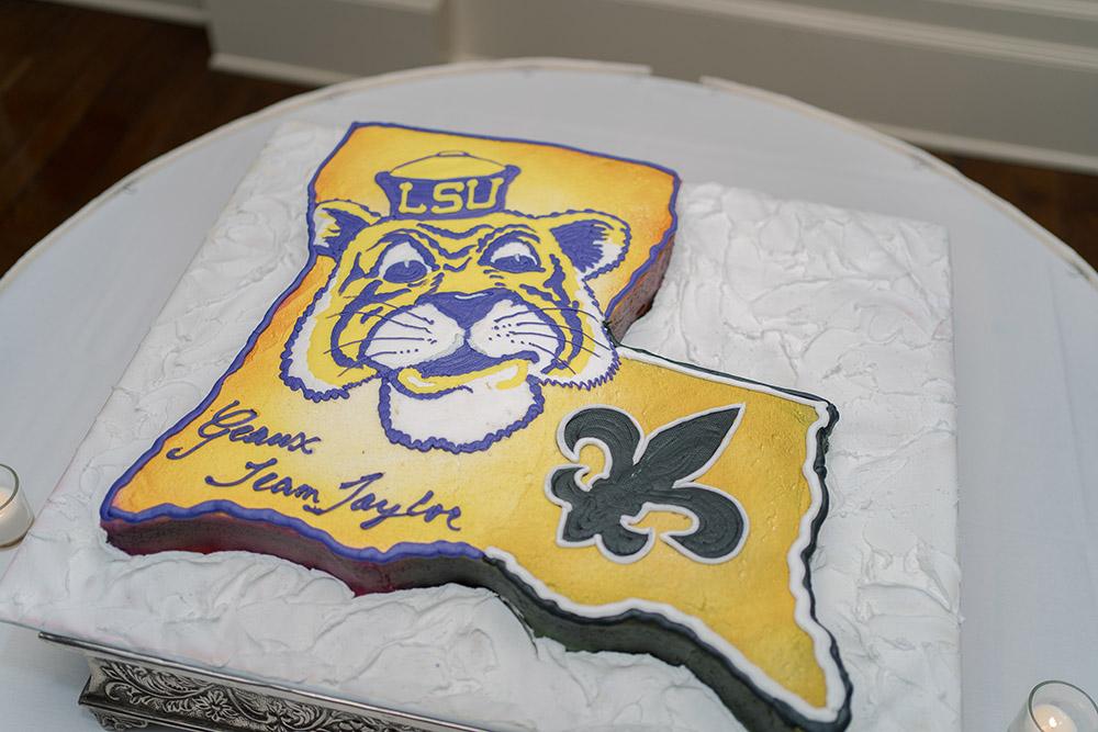 Louisiana-shaped groom's cake with Mike the Tiger and Saints Fleur De Lis