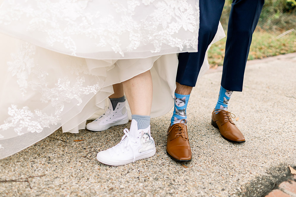 Gracie and Ross included their cats in their wedding with special shoe and sock details.