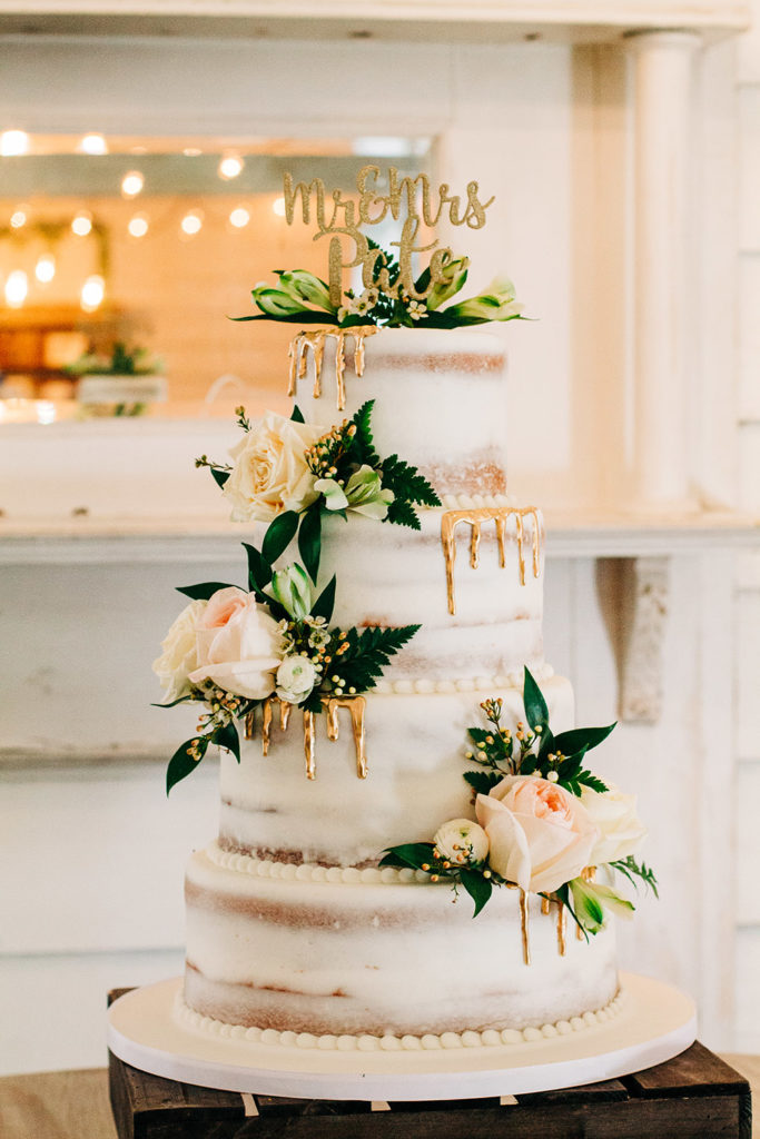 """White """"naked"""" cake with gold drip decoration and fresh flowers by Kimbla's Cakes 
