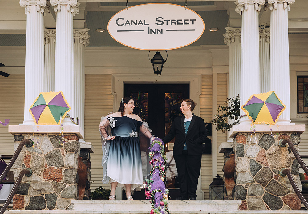 the brides on the porch of Canal Street Inn in New Orleans