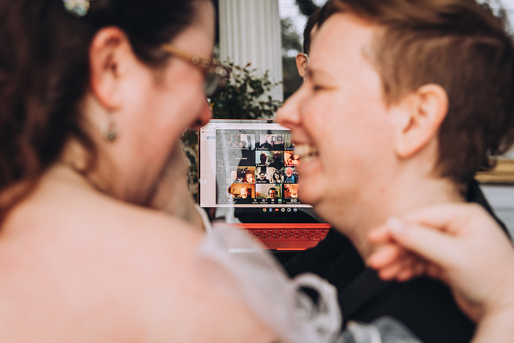 wedding guests celebrate virtually with the brides via livestream