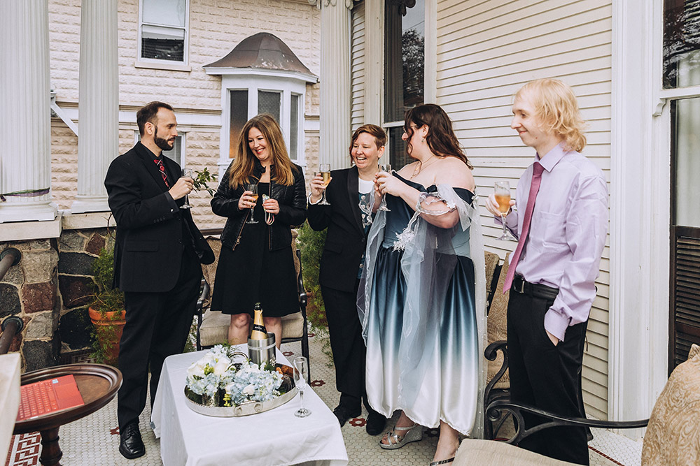 the wedding guests toast the brides