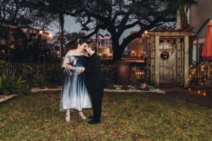 brides pose in the garden at Canal Street Inn in New Orleans