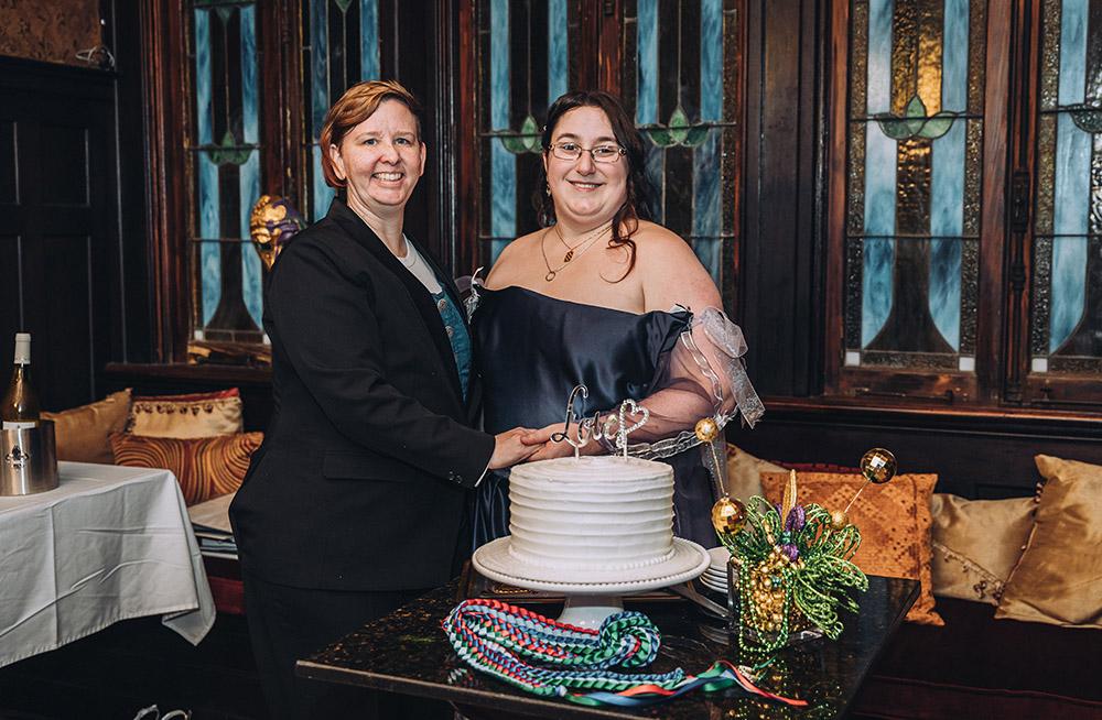 the brides cut the wedding cake
