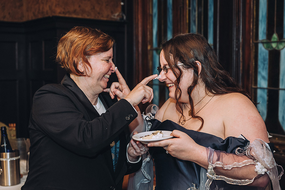 the brides dab icing on each other's noses