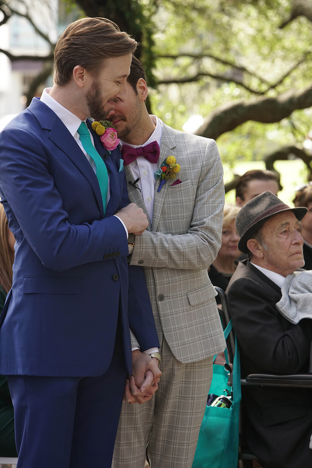 the grooms embrace during the wedding ceremony
