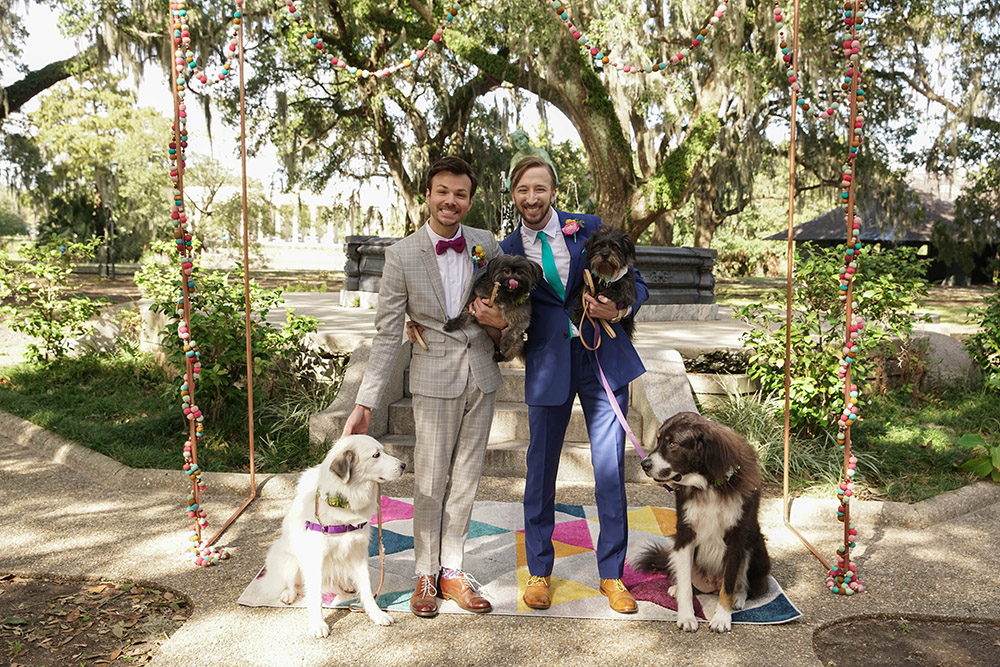 Christopher and Kyle pose for wedding photos with their four dogs