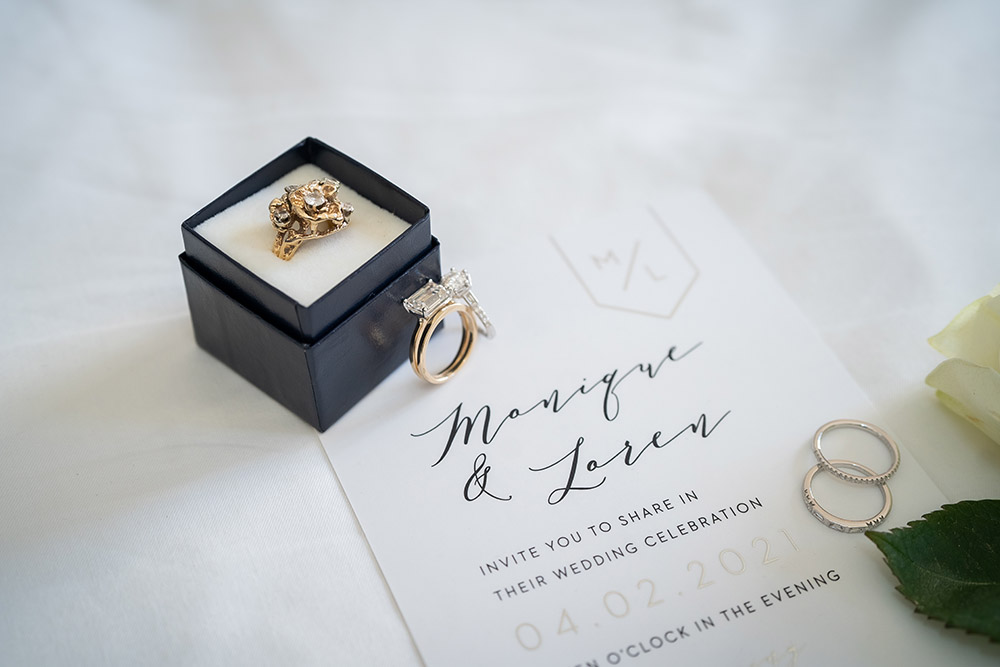 the wedding rings and wedding invitation