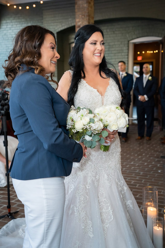 the brides are all smiles at the wedding altar