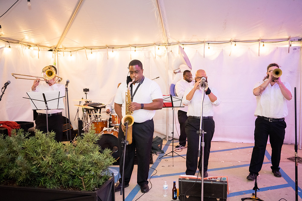 J.A.M. Brass Band performs