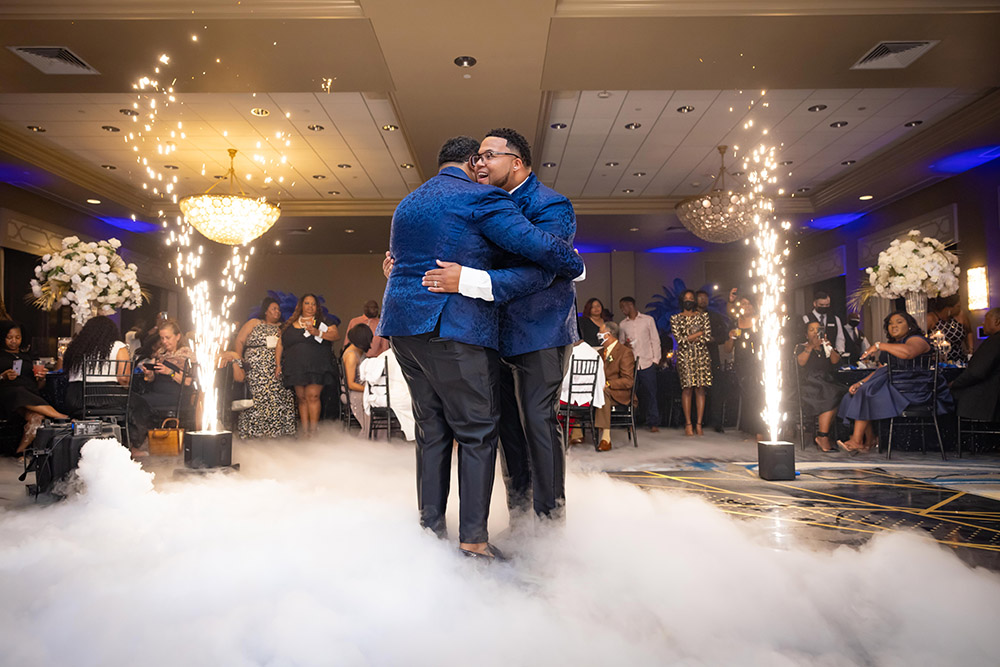 the grooms first dance with fog effects and cold spark fountains