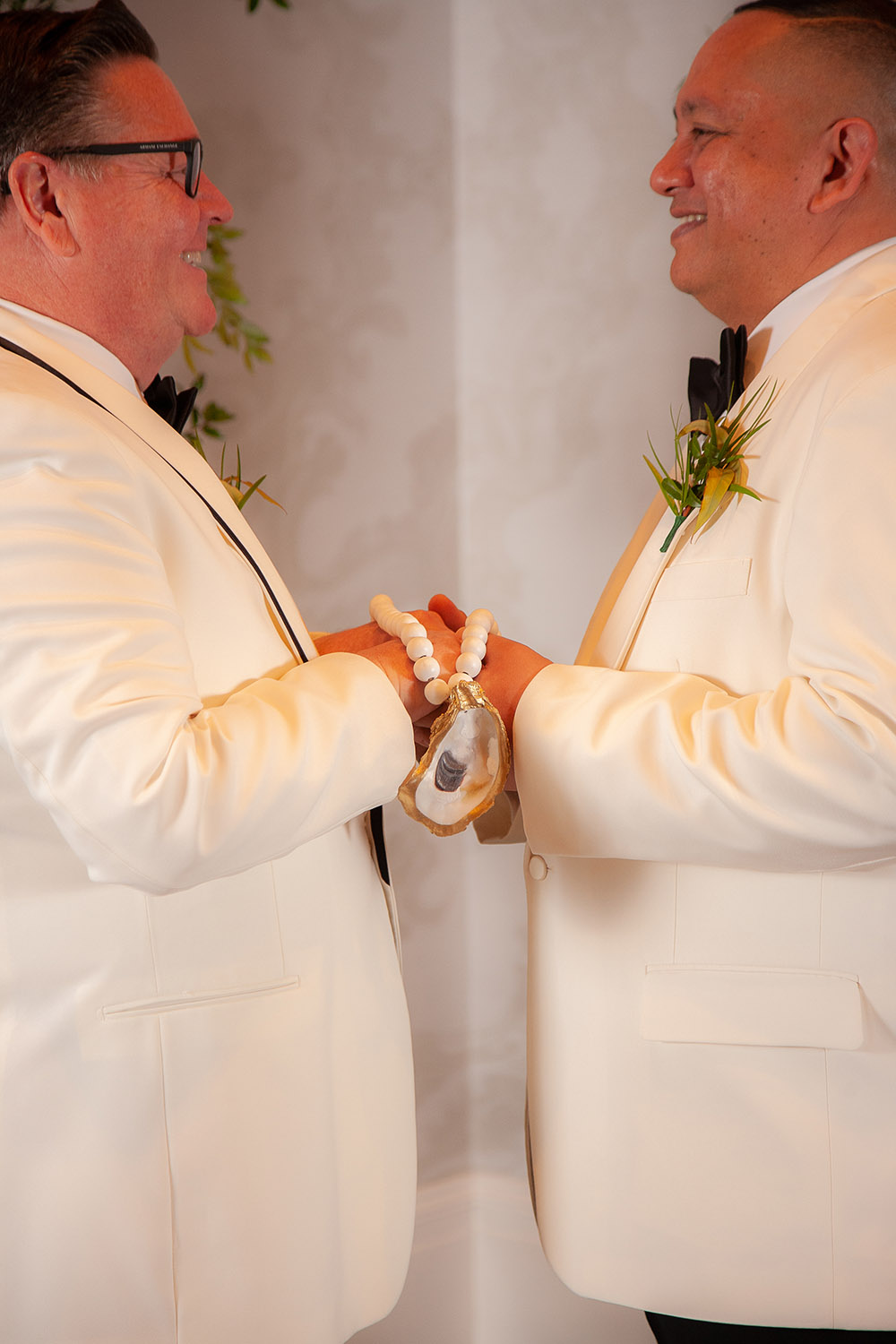the grooms hold hands