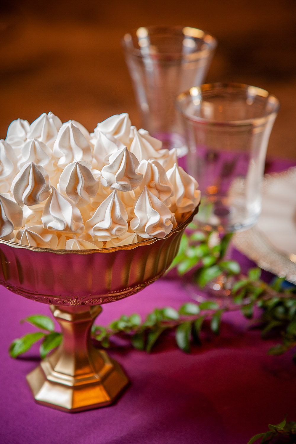 At each end of the table, we filled gold glass compotes from Peony & Petunia with light as air meringues by Lord of Meringues.