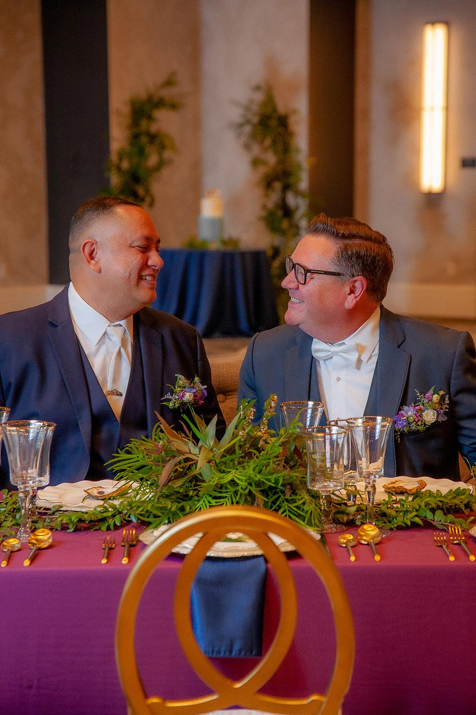 the grooms enjoy the wedding reception