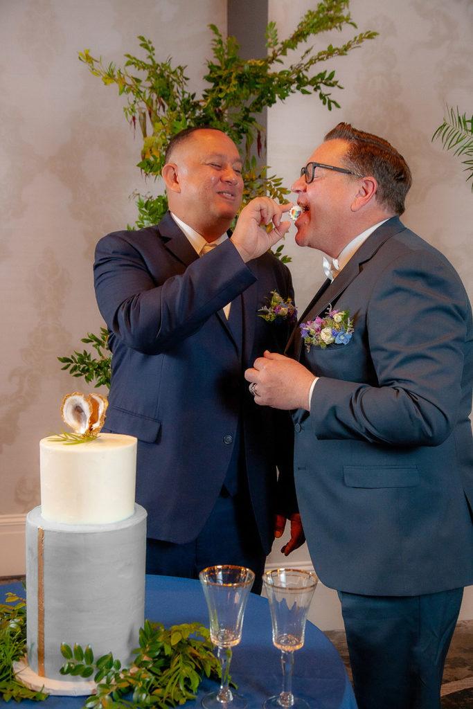 the grooms feed each other pride meringues