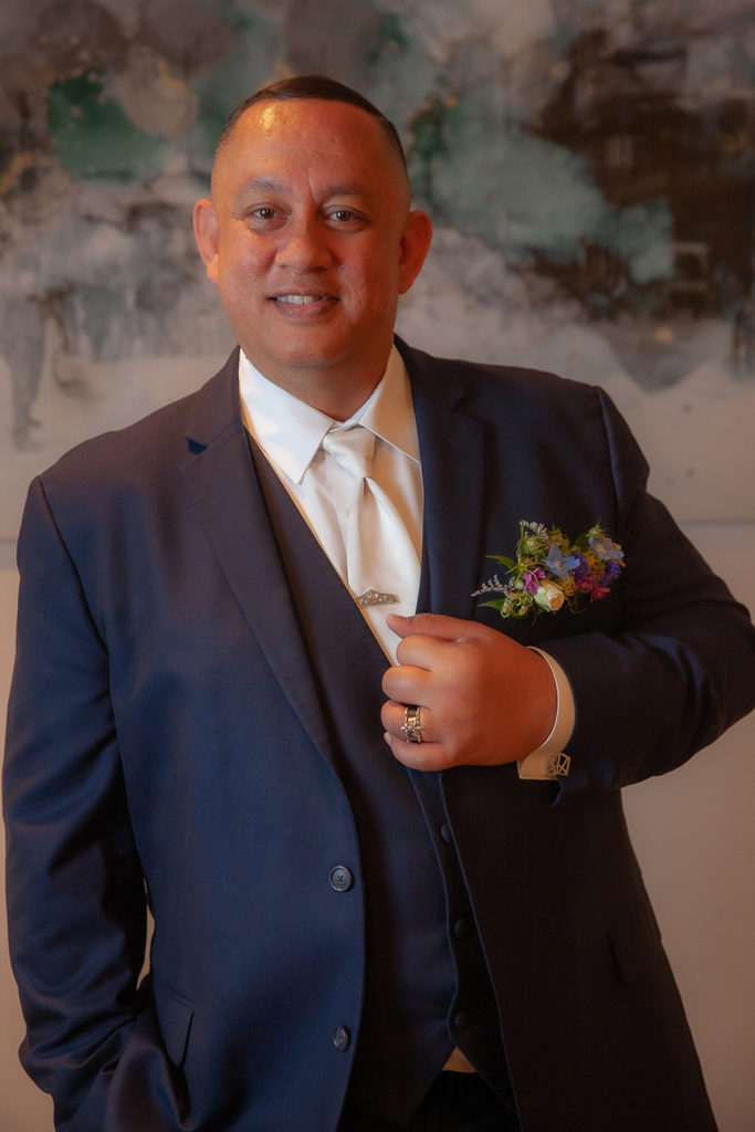 Jonathan wears a navy suit for the reception