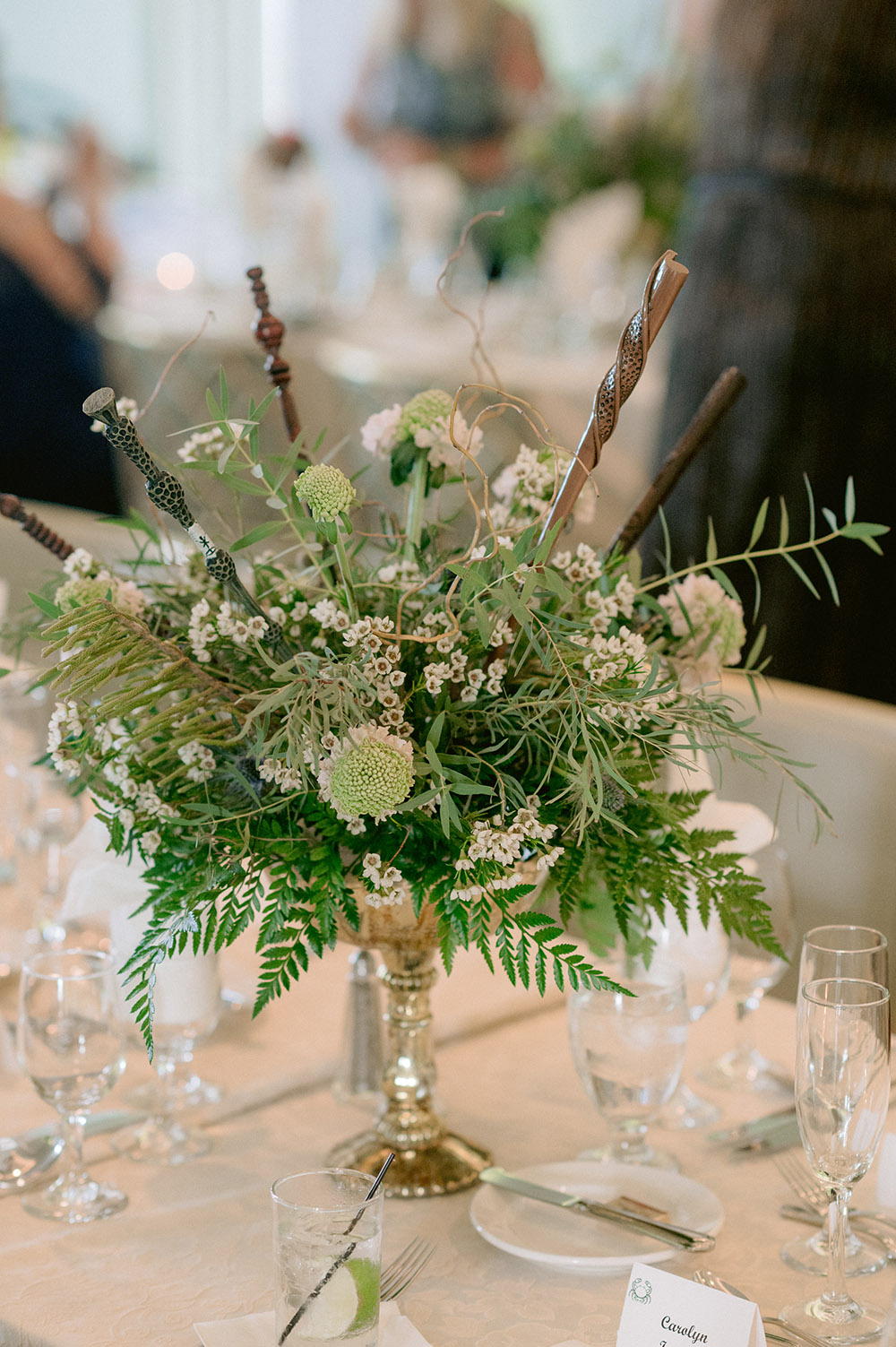 floral centerpiece with wands